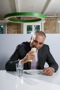 Businessman Eating Burrito